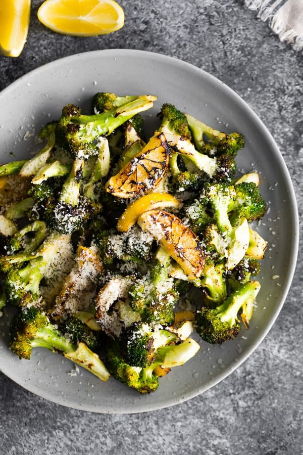 grilled broccoli on grey plate
