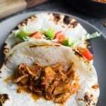 gray plate with salsa chicken in fajitas