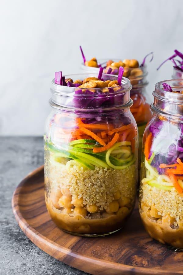Thai Chickpea Mason Jar Salad on wooden tray