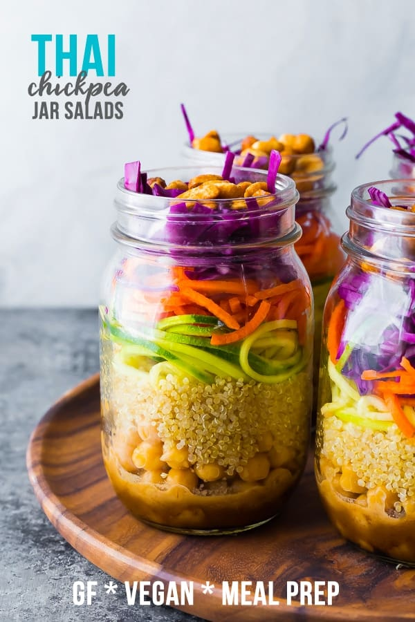 Thai chickpea mason jar salad has a tangy peanut dressing, quinoa, zucchini, carrots and cabbage and is topped with honey roasted peanuts! Ready in under 25 minutes. #sweetpeasandsaffron #vegan #glutenfree #mealprep #salad #masonjar #jarsalad #lunch
