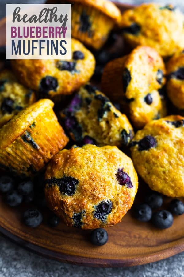 Healthy blueberry muffins are the perfect blend of healthy and delicious! With greek yogurt, whole wheat flour, no refined sugar and a TON of blueberries! #sweetpeasandsaffron #mealprep #snack #muffins #healthy #blueberries