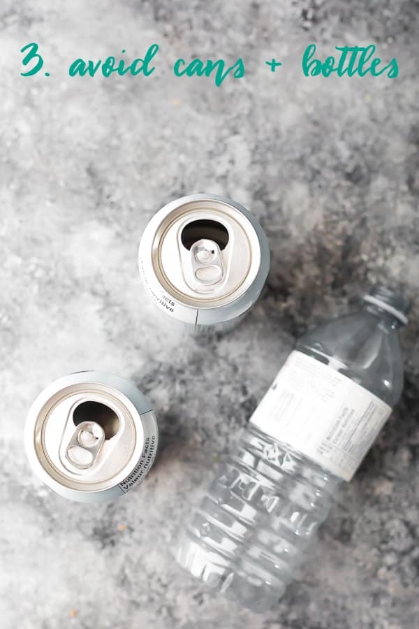 overhead shot of two cans and a plastic bottle with text avoid cans and bottles