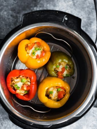 overhead shot of instant pot with turkey stuffed peppers inside