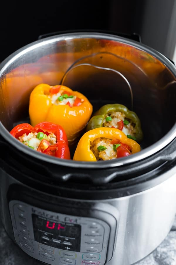 side view of turkey stuffed peppers in instant pot