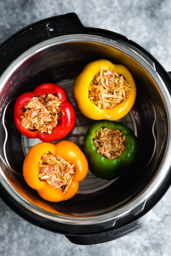 uncooked stuffed peppers with rice in instant pot
