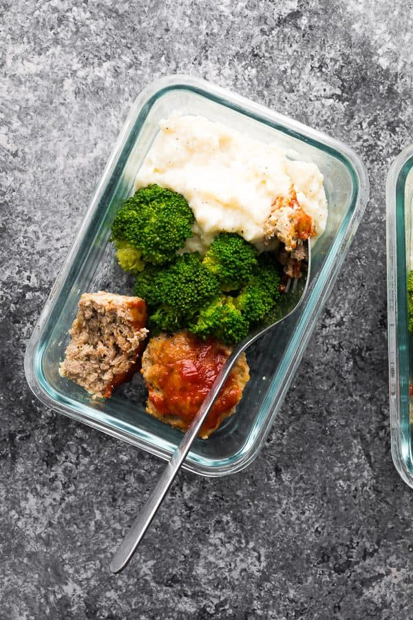 overhead shot of low carb meatloaf and caufliflower mash in glass meal prep container