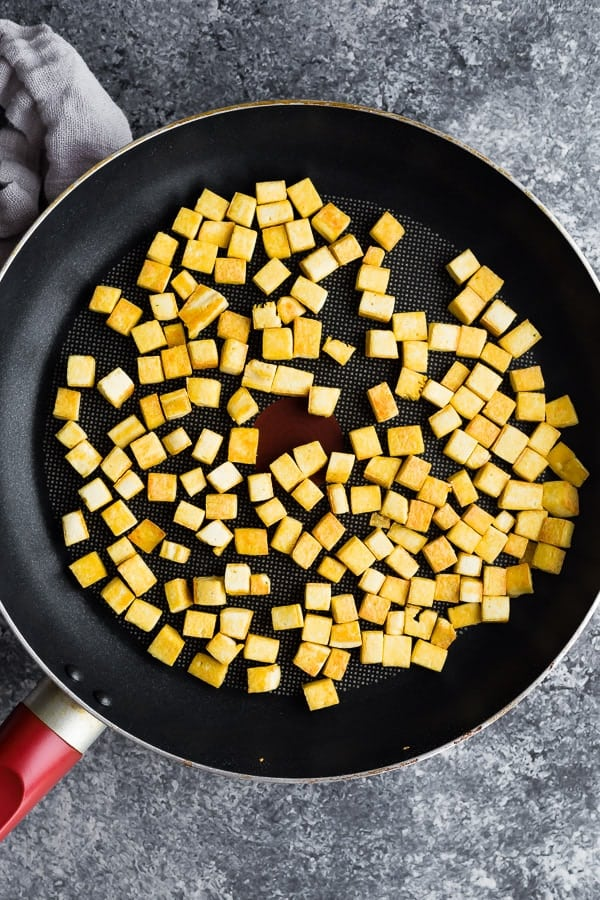 overhead shot of peanut ginger tofu stir fry in frying pan