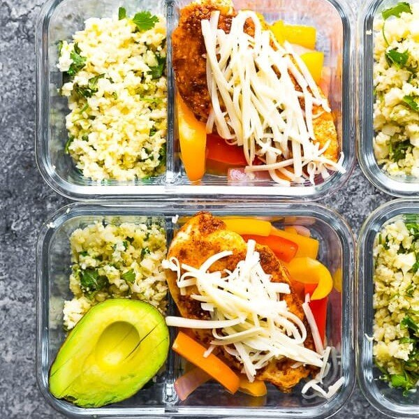 four glass meal prep containers with santa fe chicken meal prep bowls