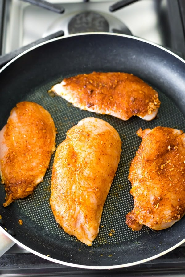 cooking the chicken in a frying pan for the santa Fe Low Carb Chicken Meal Prep