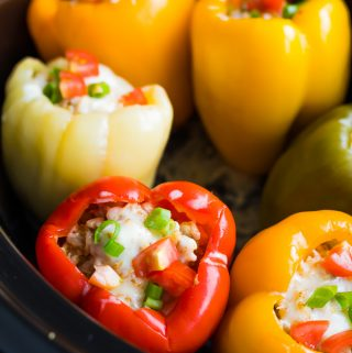 close up shot of stuffed peppers in crock pot