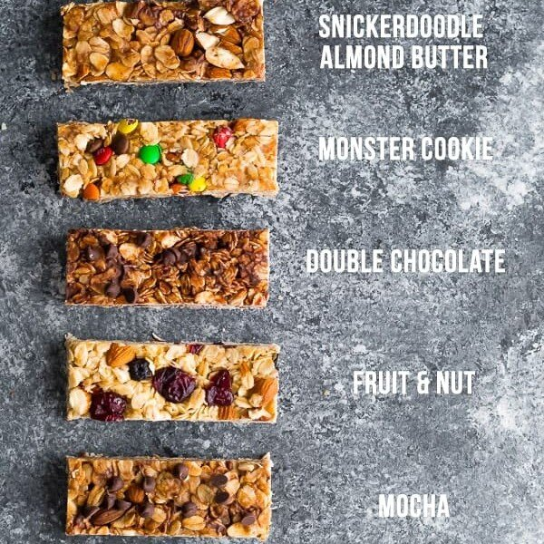overhead shot of 7 different flavors of homemade granola bars on gray background