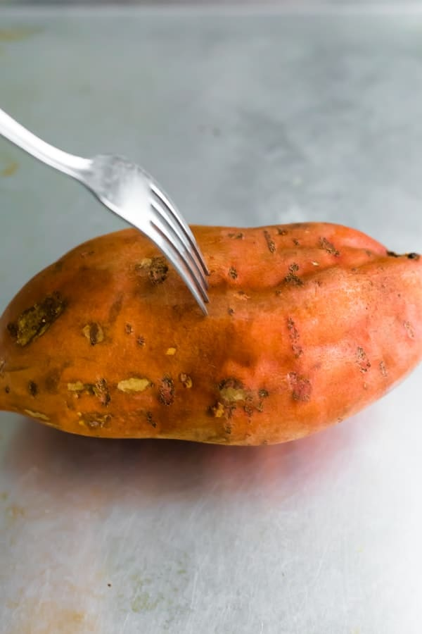 how long to bake sweet potatoes- pricking sweet potato with a fork before baking