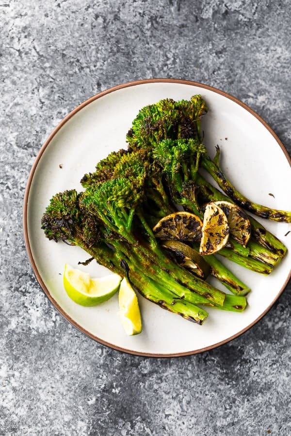 plate with grilled broccolini with chili and lime