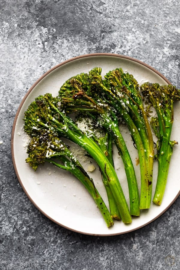 plate with roasted broccolini with balsamic vinegar and parmesan cheese
