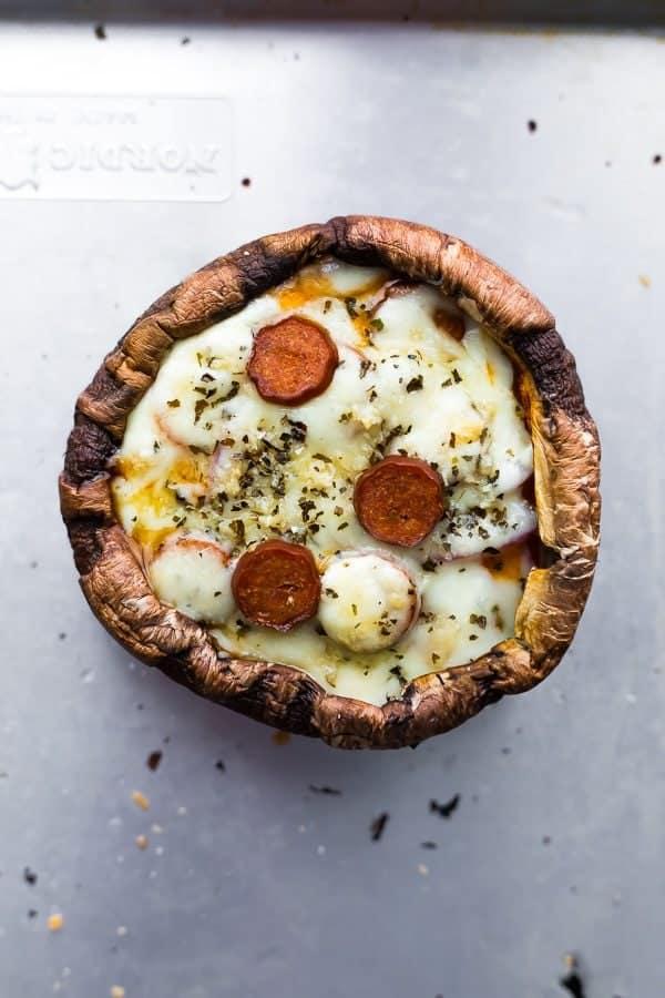 overhead shot of pepperoni pizza stuffed portobello mushroom