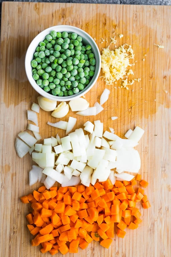 ingredients on chopping board for the cauliflower fried rice recipe