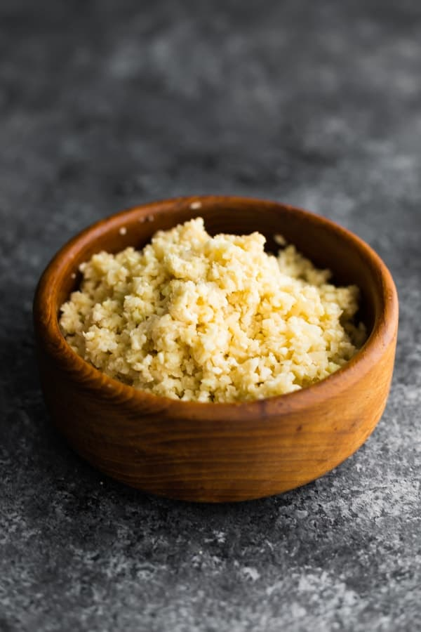 Coconut cauliflower rice in brown bowl