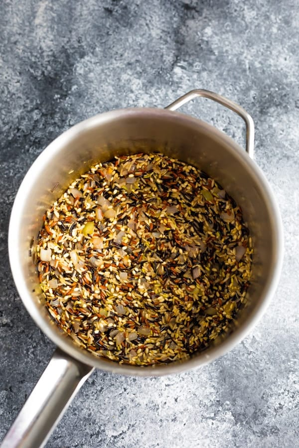 toasting the rice for the wild rice pilaf in a pot