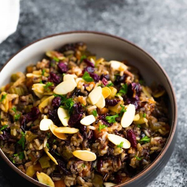 bowl of cranberry almond rice pilaf on gray background