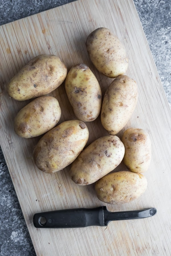 potatoes for the homemade mashed potatoes on a cutting board