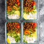 overhead shot of four glass meal prep containers filled with korean bbq chickpea bento