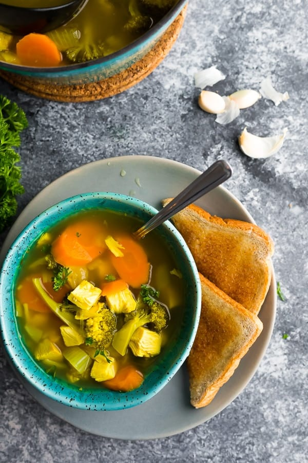 detox soup in blue bowl with toast