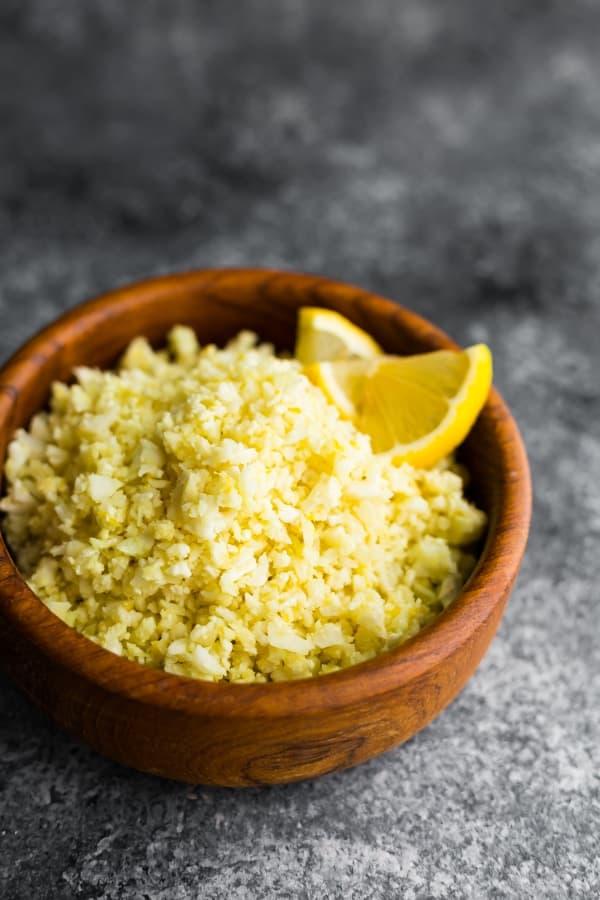 Lemon Garlic Cauliflower Rice in brown bowl