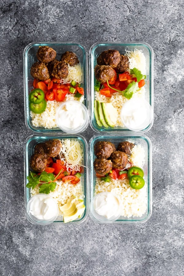 overhead shot of four glass meal prep containers with Low Carb Meatball Burrito Bowls