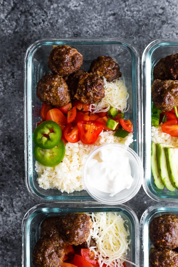 overhead view of Low Carb Meatball Burrito Bowls in glass meal prep containers