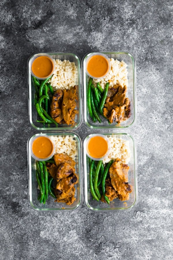 four low carb satay beef meal prep containers
