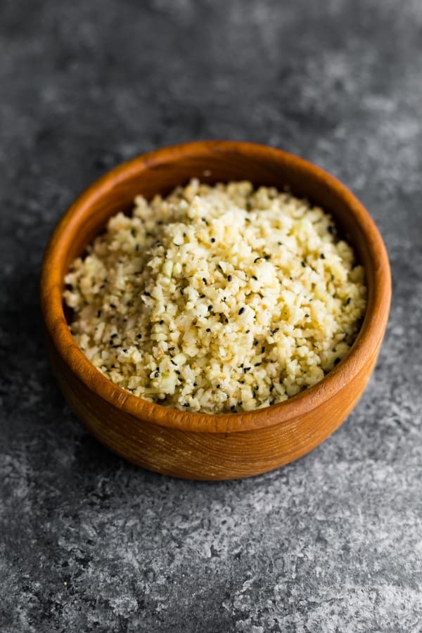 sesame ginger cauliflower rice recipe in brown bowl