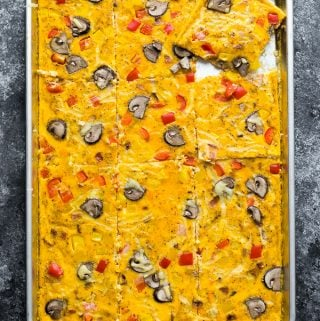 overhead shot of sheet pan eggs on gray background