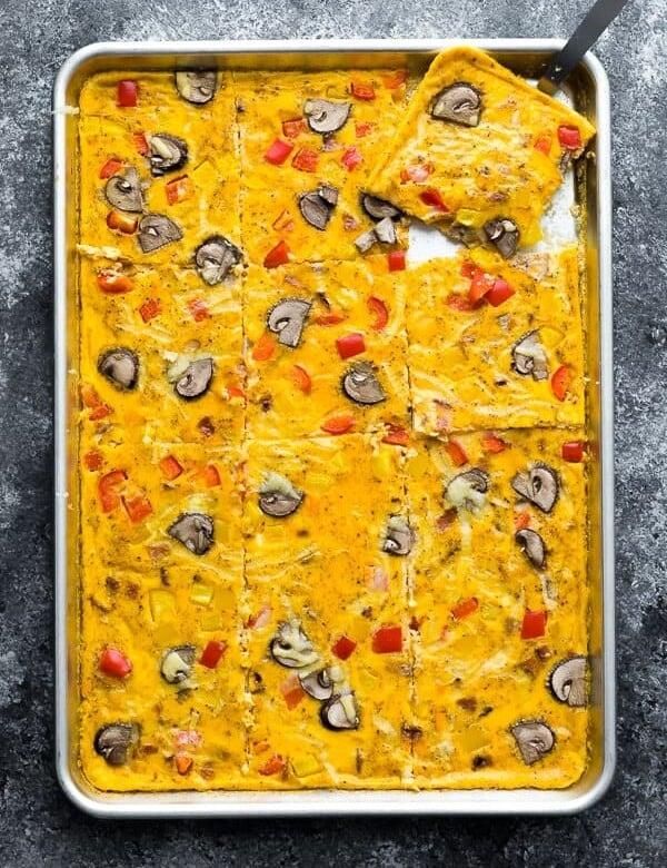 overhead shot of sheet pan eggs on gray background