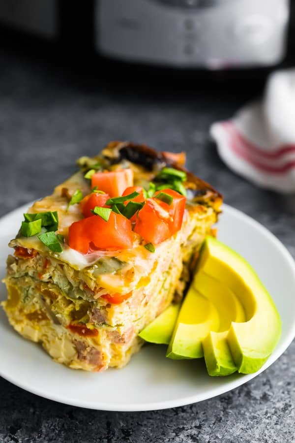 crockpot breakfast casserole on plate with sliced avocado