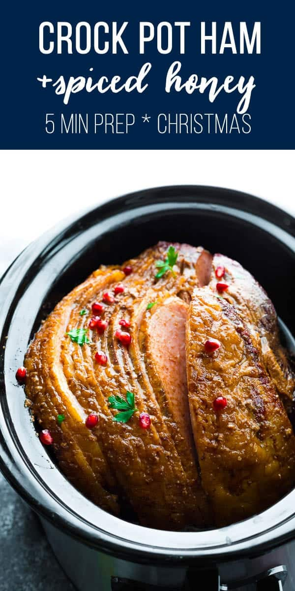 Crock pot ham with spiced honey is the perfect hands off dinner for your holiday table! Only a handful of ingredients and only ten minutes prep work required. crockpot ham, christmas ham, slow cooker ham #sweetpeasandsaffron #ham #slowcooker #christmas