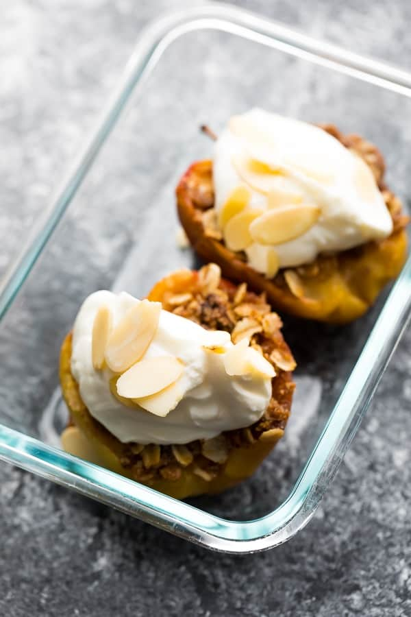 baked apples in meal prep container with yogurt and almonds