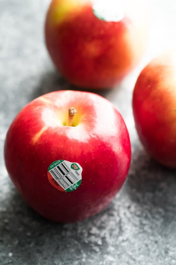close up shot of apples with bc tree fruit sticker to be used in baked apple recipe