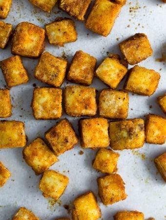 overhead shot of baked tofu cubes on baking pan