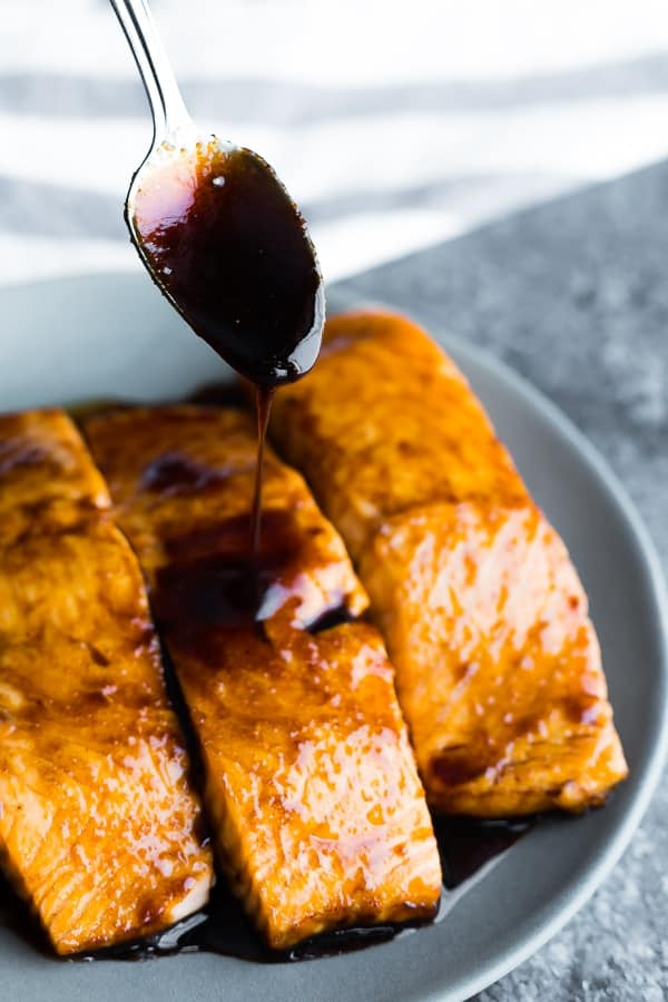 how long to bake salmon; spooning glaze over the cooked fillet