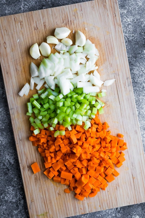 chopped vegetables on cutting board for beef and barley soup