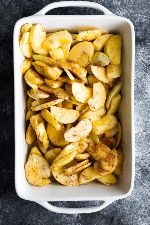 sliced apples in baking dish for easy apple crisp recipe