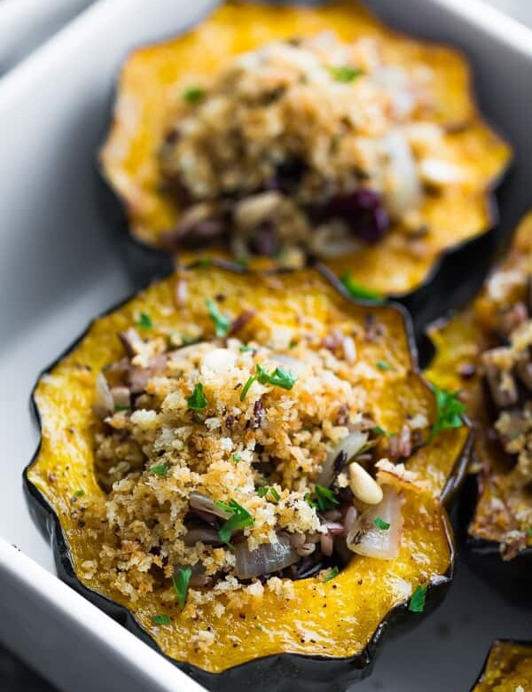 close up shot of stuffed acorn squash with mushrooms and cranberries