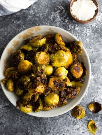 overhead shot of balsamic roasted brussels sprouts in large white bowl