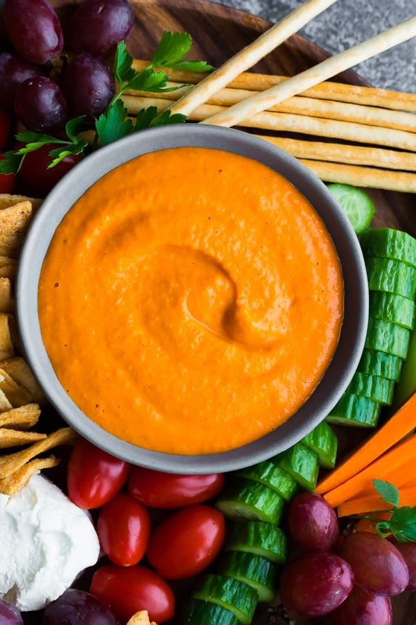 overhead view of the homemade roasted red pepper hummus on an appetizer tray