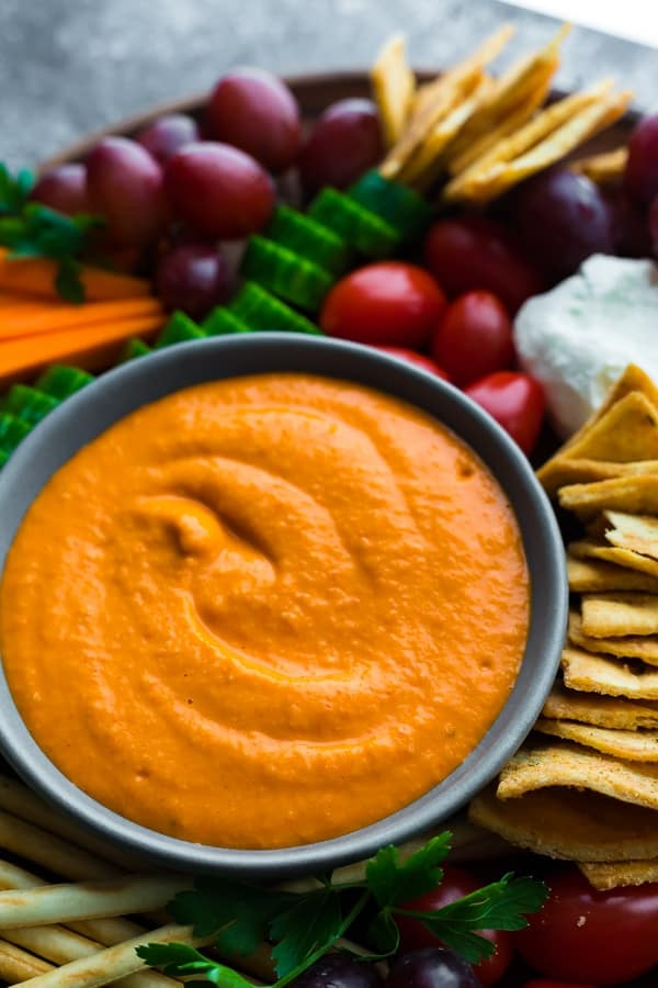 roasted red pepper hummus on an appetizer tray