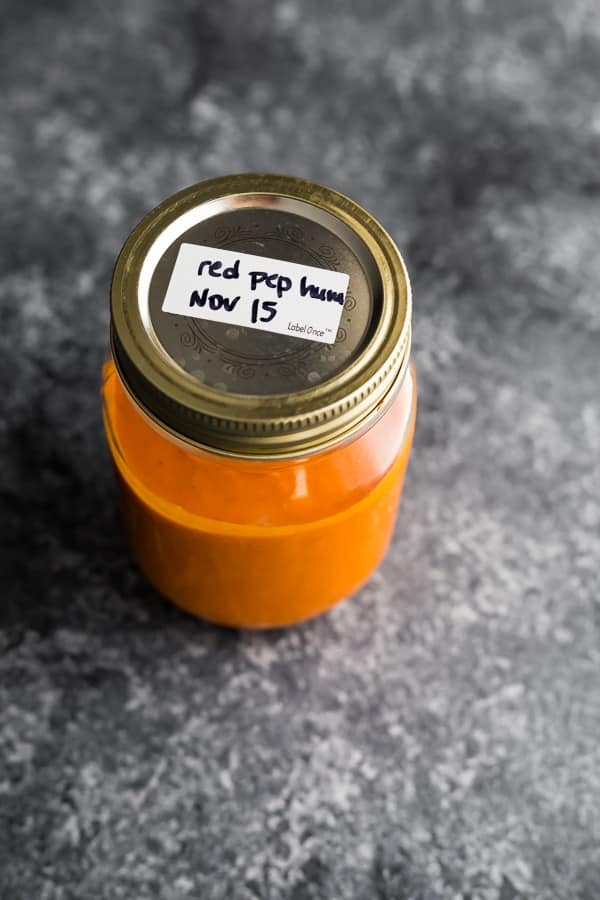 roasted red pepper hummus in a mason jar before freezing
