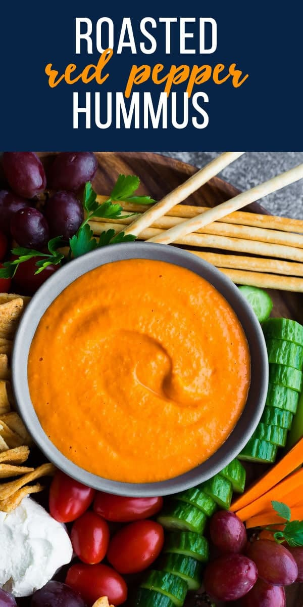 Roasted red pepper hummus is creamy and such a pretty color! Perfect for a snack or your holiday table. #sweetpeasandsaffron #vegan #glutenfree #hummus