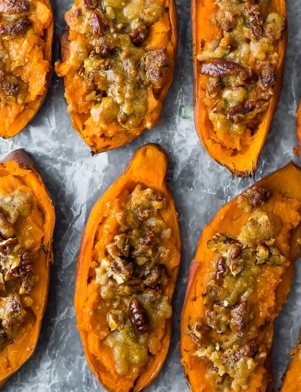 overhead shot of twice baked sweet potatoes in a row on parchment
