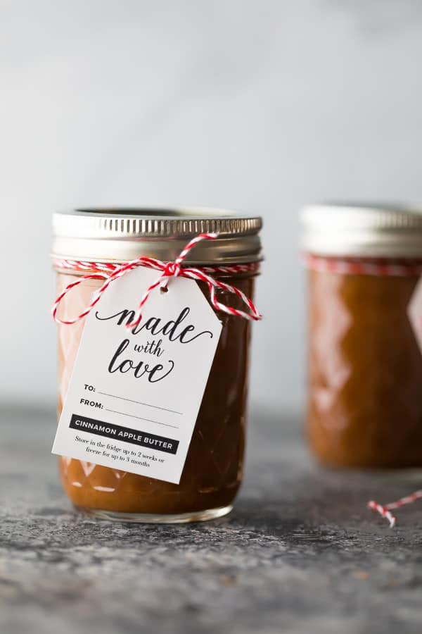 apple butter crockpot recipe in mason jar with gift tag