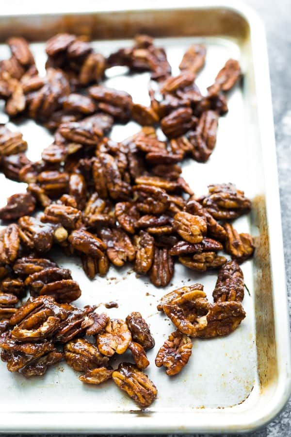 showing how to roast pecans on a baking dish